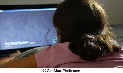 girl playing in the notebook online game laptop - girl...
