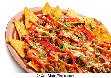 spicy nachos with pork, tomato and pepper