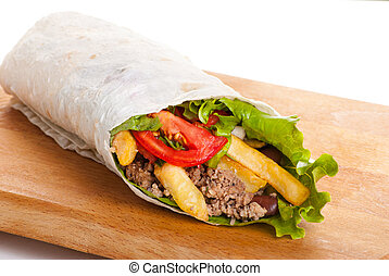 beef burrito with peppers, fried potato and tomato