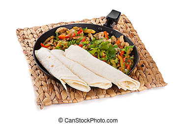 traditional mexican beef fajitas with tortillas on white...