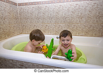 bathtub baby twins stock photos and images 16 bathtub baby twins pictures an. Black Bedroom Furniture Sets. Home Design Ideas