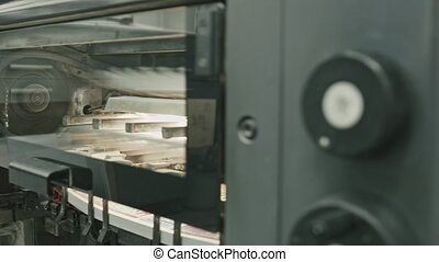 Professional printing machine in action, polygraph industry,...