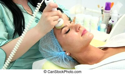 Hardware cosmetology. Cleaning the skin with a brush. -...