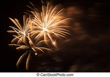 Fireworks in the night sky - Outbreaks of fireworks in the...