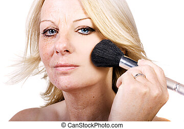 Brush your flaws away - A close up of a middle aged woman...