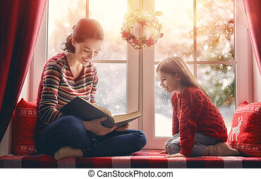 mother reading a book - Merry Christmas and happy holidays!...