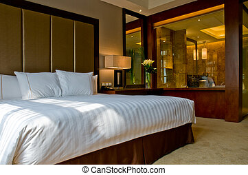 Bedroom of a elegant 5 star hotel suite room and attached...
