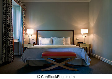 Bedroom of a elegant 5 star hotel suite room