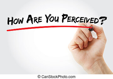 Hand writing How Are You Perceived? with marker, concept...