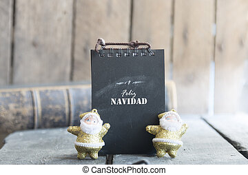 Greetings in spanish language. Feliz navidad card - Merry...