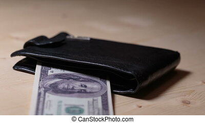 Money comes in a purse stop motion. Money in wallet. Wallet...