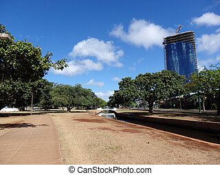 Concrete Path and stream in Ala Moana Beach Park surrounded...