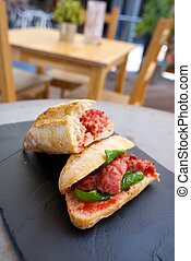 Sausage snack - Sausage butty with green pepper and tomato.