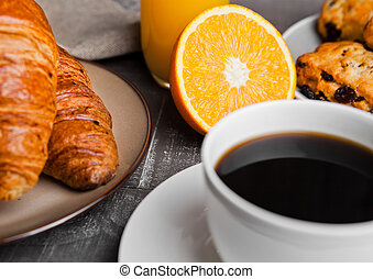 Healthy breakfast with coffee juice fruits pastry