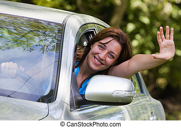 Happy woman in car - Young woman happy about her new car