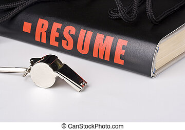 Big resume - A silver whistle laying next to a very long...