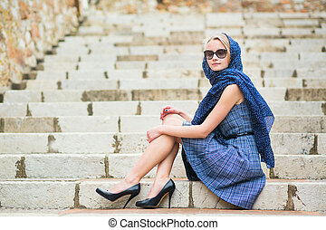 Elegant French woman in Cannes, at Le Suquet
