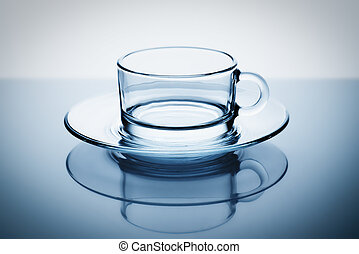 Glass coffee tea cup on a blue background