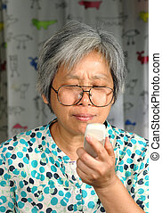 middleage woman looking on phone