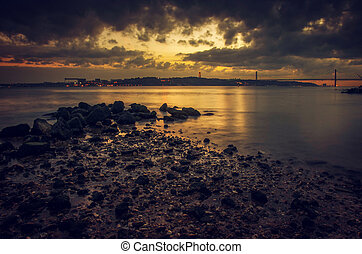 Tagus Evening - View of Tagus river and 25 of April bridge...