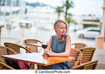 French woman in an outdoor cafe of Cannes - Young French...