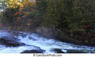 Algonquin river rapids in beautiful autumn colors - An...