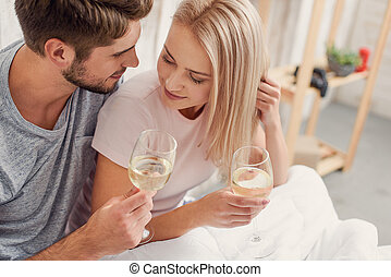 Lets drink for us - Happy loving couple is drinking wine and...