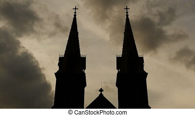 Black silhouettes of the towers of the Catholic Church.