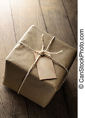 Brown Paper Parcel with String and Blank Weathered Label