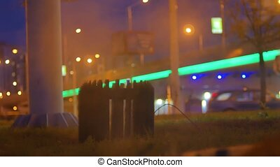 Night city in the steam from the sewer expressway in the...