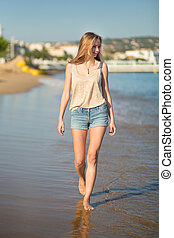 Beautiful girl on the beach in Cannes, France