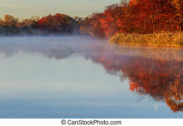 Autumn foggy morning. Dawn on the misty tranquil river