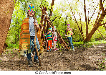 Cute boy playing Red Indian chief in the forest - Portrait...