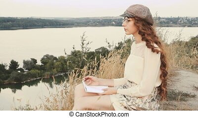 Student or writer on the nature concept - Woman writer...