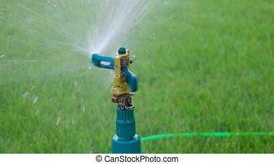 Head garden sprinkler slow motion hd footage - Head of...