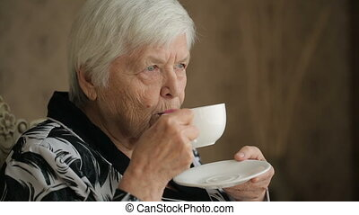 Senior woman enjoying a tea - Senior woman enjoing cup of...