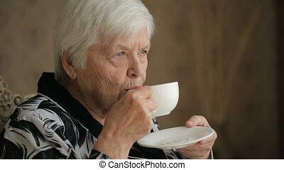 Senior woman enjoying a tea - Senior woman enjoing cup of...