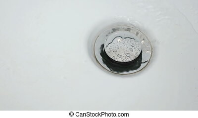 The process of draining water in the bathroom. Close up