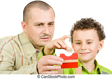 Father and son playing - Father and son building a castle...