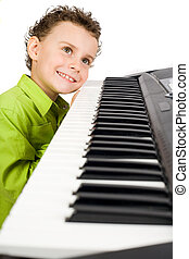 Cute kid playing piano - Cute little boy playing synthesizer...