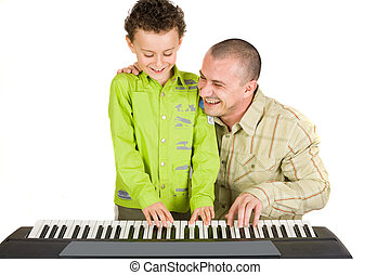 Father and son singing - Father and son trying to play to a...