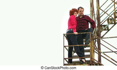 Couple standing on the stairs