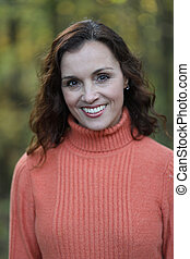 Woman with Brown Hair Against a Fall Background - Photo of a...