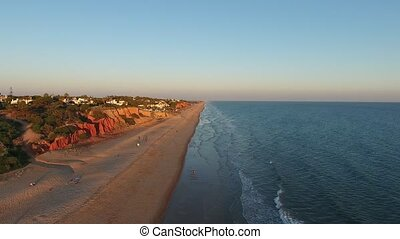 Magical sunset over the beach of Vale de Lobo. Tourist town of Portugal. Algarve.