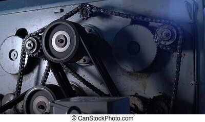 Sawmill. View of gears and chain rotate on machine -...