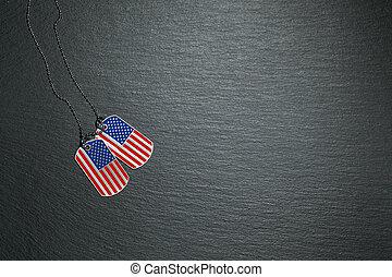 USA dog tags on slate background