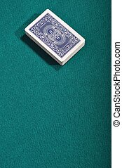 Playing cards - playing cards deck on a green cloth...