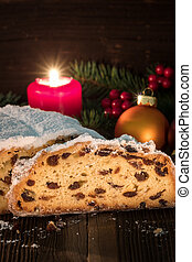 Stollen on a wooden table with a rustic background.