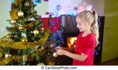 cute girl decorating christmas tree