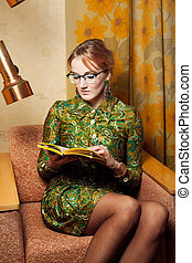 Portrait of a beautiful lady - 1970s vintage lady reading a...